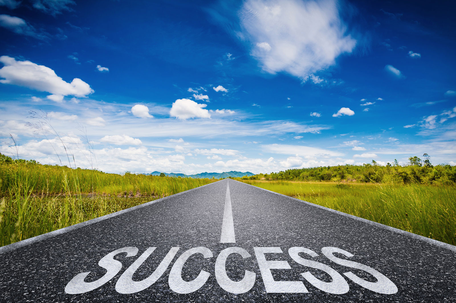a road with the word success on it